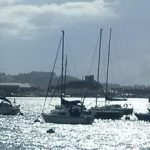 Plym Yacht Club - Photograph of yachts on moorings in front of the clubhouse on the Cattewater, Plymouth